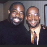 Kirk Nugent and Les Brown speaking at The National Arena in Kingston, Jamaica